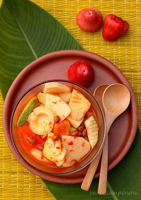 Asinan Bogor. Salted Fruits Pickle. Served with red sweet and sour dressing and special crackers (kerupuk)