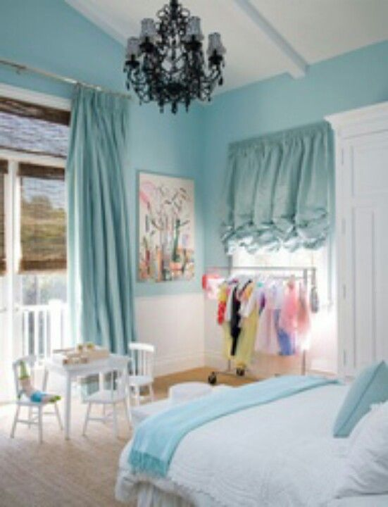 Light Blue Girls Bedroom With Black Chandelier And Ruffle Curtains. I Like  The Small Dress Up Clothes Rack.
