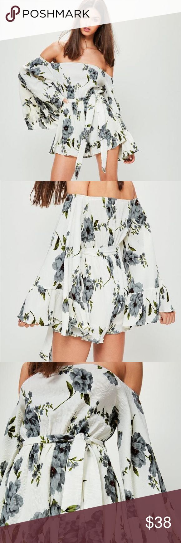 """Missguided Crinkle Floral Print Playsuit NWT! Missguided playsuit size 4. Step up your florals and slip into this crinkle effect romper featuring a delicate floral print, bardot style, off the shoulder, extra wide bell sleeves and waist tie to cinch your waist. Lining at the bottom.  100% polyester  approx front length 28"""", across bust 18"""" Missguided Dresses"""