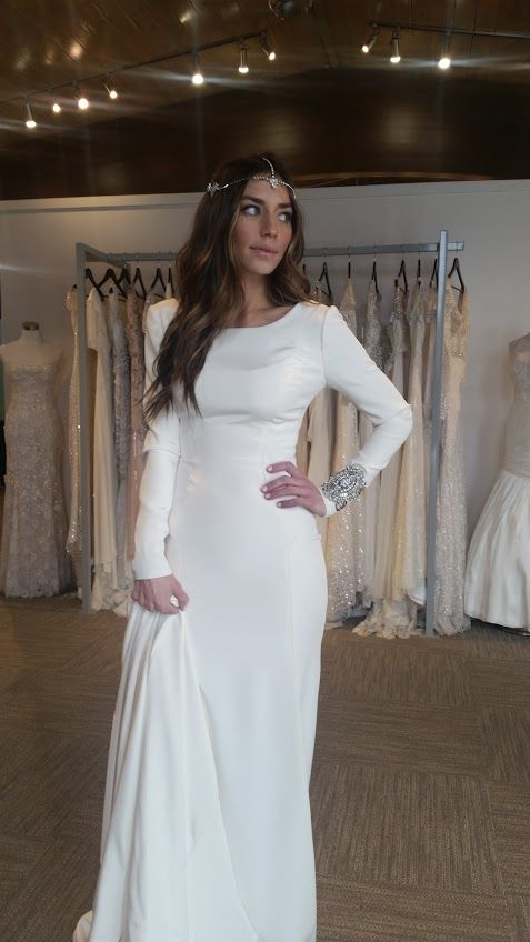 modest wedding dress with long sleeves and a long train from alta moda bridal.