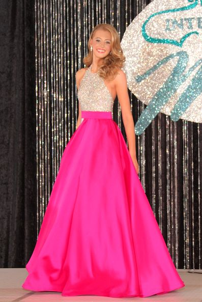 Haleigh Hurst, International Junior Miss Texas Jr. Teen 2016, looks absolutely stunning in this fuschia ball gown!  The Color -   This bright pink color was a great choice for Haleigh! Pink is a great color for younger contestants since it helps to keep the overall look very youthful and fun. This darker pink color looks great against Haleigh's lightly tanned skin.