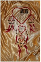 Heart Shaped Mirrored Dream Catcher (Medium): A medium sized gorgeous contemporary designed heart shaped dream catcher with hanging mirrors set in the webbing, measuring approximately 15cm in diameter.     This dream catcher comes in various amazing colours.  Choose from Red, Pink, Purple and Aqua.