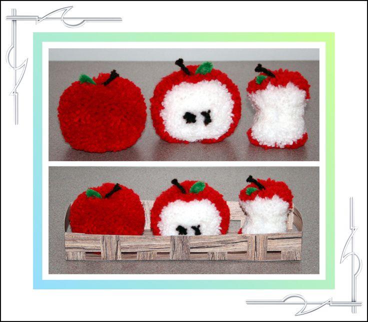 Sculptured Yarn, pom poms, pompoms, set of apples in crate, half eaten, core