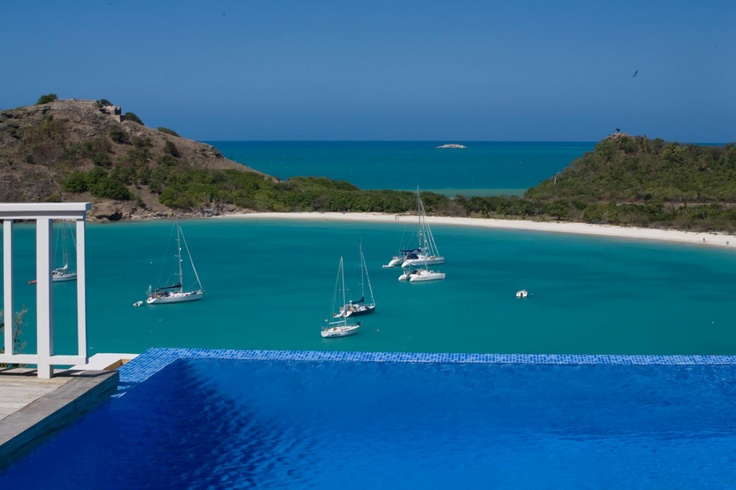 Sailing boats at the bay in front of Capri luxury villa in Antigua, Caribbean