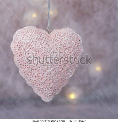 Pale pink lace heart decoration effect - stock photo