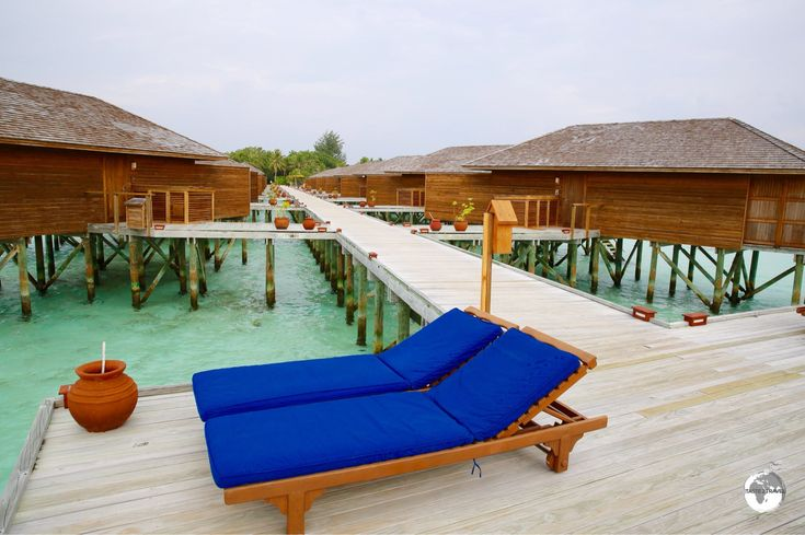 The 'Jacuzzi Water Villas' are accessed via an over-the-water boardwalk.