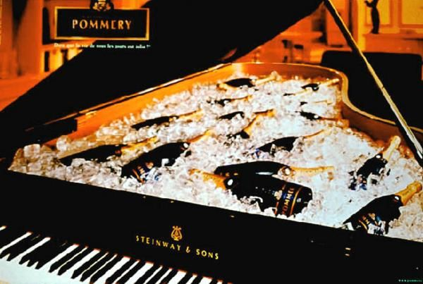 Pommery Champagne ad - bottles chilling in piano