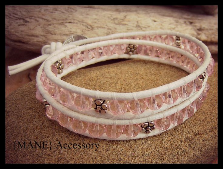 White and pink leather wrap bracelet. Beaded with Pink Czech crystal beads and silver daisies.