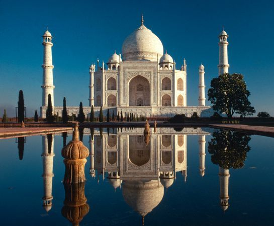 The Taj Mahal, in Agra, India, is the spectacular mausoleum built by Muslim Mughal Emperor Shah Jahan to honor the memory of his beloved late wife, Mumtaz Mahal.