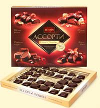This box of assorted chocolates contains four types of chocolate candies and dark chocolate, includes praline and cream fillings.  430g