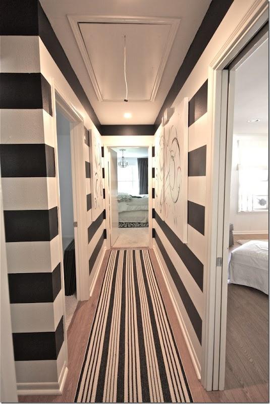 bold stripes add interest to a narrow hallway