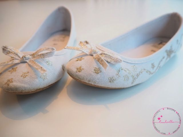 Little girls ballerina shoes painted with golden fabricpaint