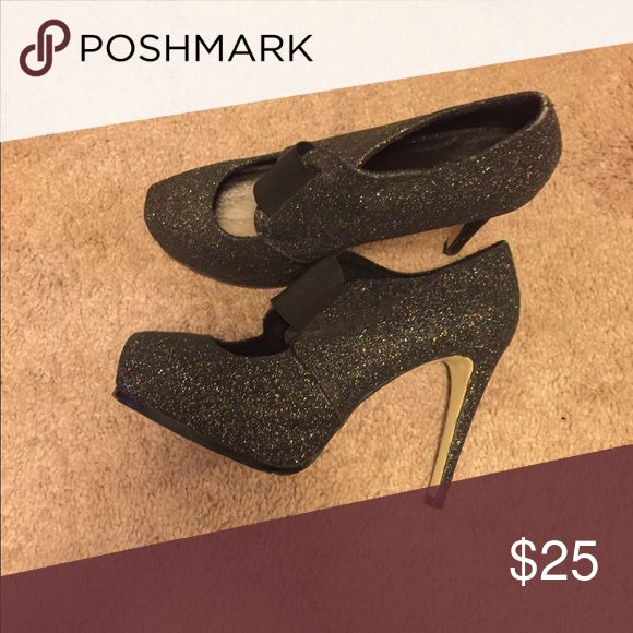 Black Sparkle Heels Black sparkling heels with strap that goes across the front. Shoes Heels
