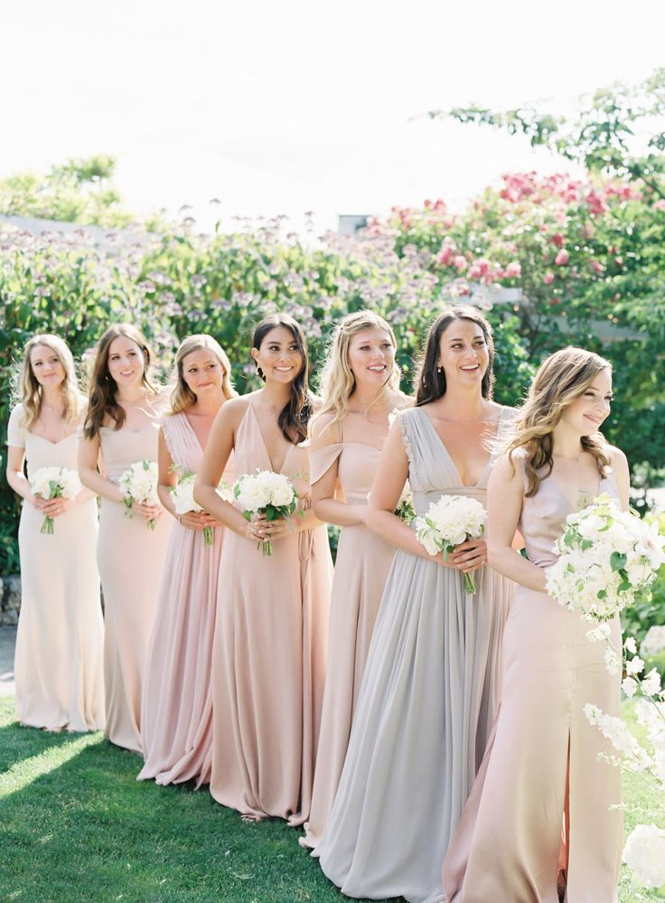 pastel bridesmaid gowns in various hues  | Photography: O'Malley Photographers