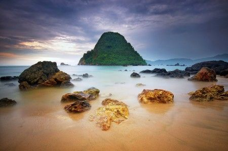 Hendri Suhandi: The Beauty of Pulau Merah Beach, Banyuwangi, East Java, Indonesia. The water has different colors, and the view was very breathtaking. White sandy beach, beautiful and gorgeous sunrise and sunset, perfect for snorkeling and surfing.