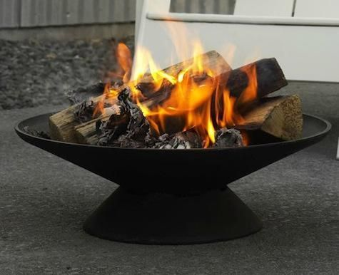 Cast-Iron Fire Bowl Cast Iron Fire Bowl  DWR. Made with an efficient conical shape, the lower bowl collects ash and elevates the flames off the ground to better dissipate heat. The cone grate in the upper bowl creates an air pocket from which the fire can draw, while also creating a more efficient burn by focusing the fire into the center. The simple, efficient design has two built-in handles for portability.