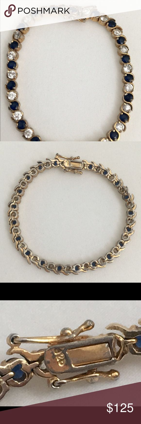 "Gold Over 925 Silver Sapphire Tennis Bracelet 7.5 Lovely gold over sterling silver tennis bracelet with sparkling 21 Dark Blue Sapphires between them has secure and tight rhinestone sparkle. Push in Clasp with Safety Latches on Sides. Clasp is marked ""925"".   Measurements : Size: 7.5"" Long and Weight : 17.5 Grams Jewelry Bracelets"