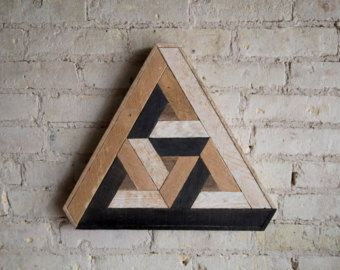 16.5in. W x 14.5in. H Handmade wood wall art with reclaimed wood pattern. We can customize sizes of this design in our shop if this one isnt just right for your space. We can customize the size and color for you, just let us know! This geometric design can be used on above a bed, sofa, or any wall needing some love. Can hung from any side. Size, color and texture will have small variations due to the nature of reclaimed wood. Made to order. Made with raw reclaimed wood. Can be customized....