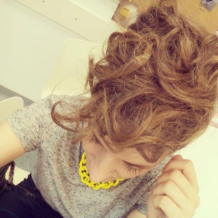 Curly messy bun.