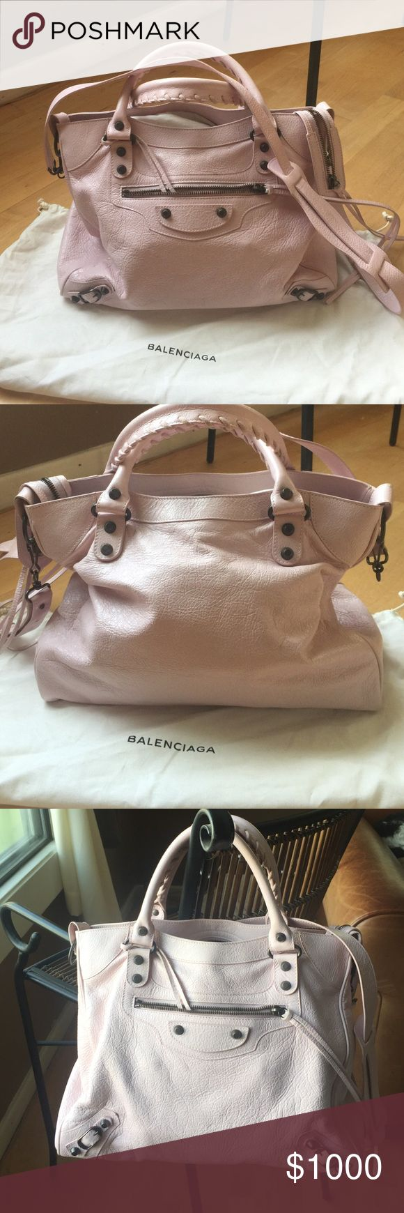 """Balenciaga Velo in rose Poudre lambskin Balenciaga Velo in powder pink """"rose Poudre"""" lambskin with dark nickel studs. Comes with small mirror, shoulder strap and dust bag. Excellent condition. No markings. Very slight rubbing along two bottom edge corners. No color transfer. Year 2014 I believe. 13.5""""w x 11""""h x 6.5"""" d. No trades. Balenciaga Bags Shoulder Bags"""
