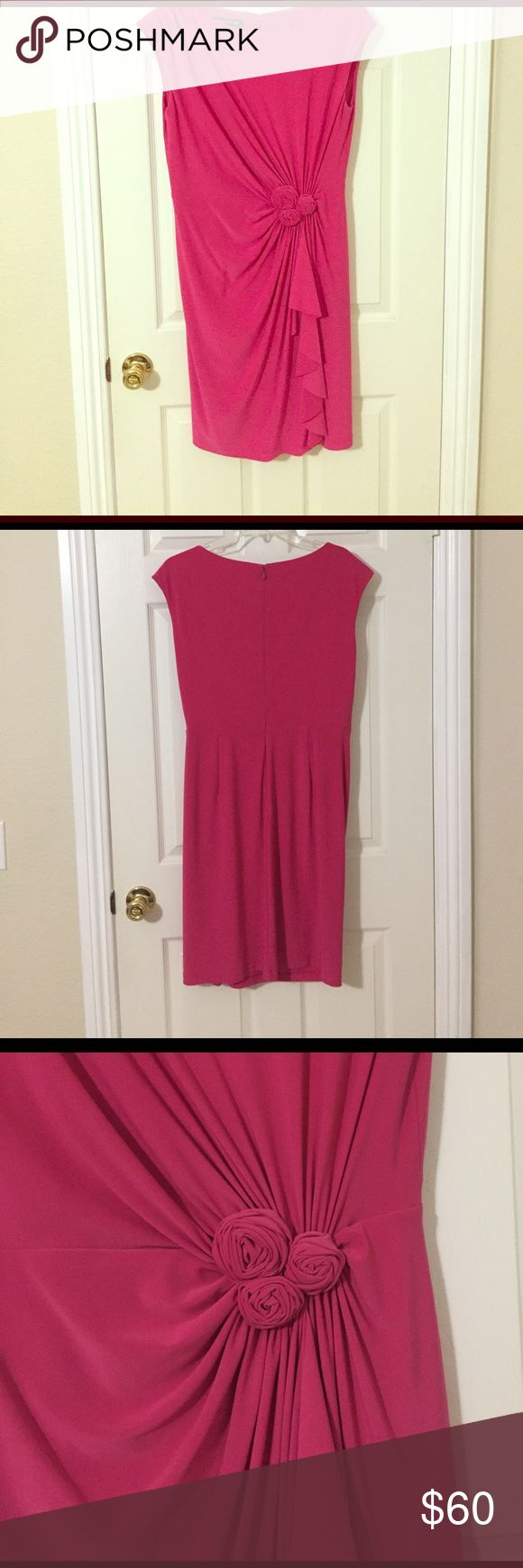 Jones New York hot pink dress Gorgeous dress for those events coming up in the spring and summer. This Jones New York dress features a cap sleeve and floral design. The material is soft and fully lined. It is very flattering and hides the midsection well. Zip closure on the back. Jones New York Dresses