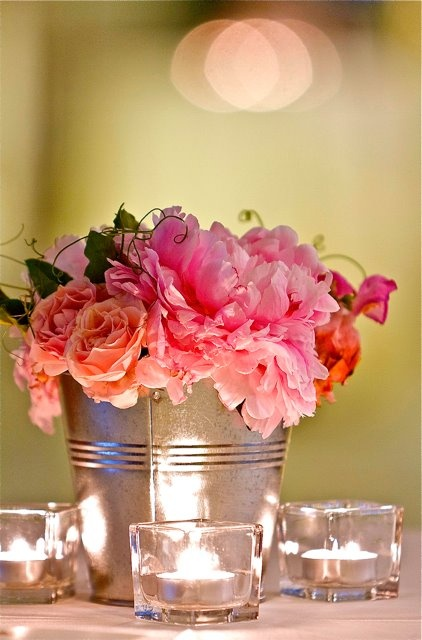 I like the way the candles shimmer off the pail. Turquoise roses and baby's…