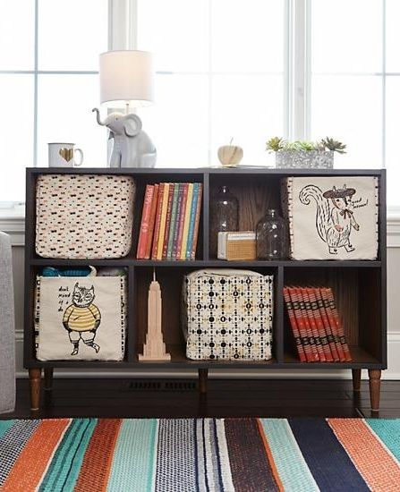 Expertly constructed to last your family for years to come, our Fulton Street Wide Bookcase is a work of true craftsmanship. Featuring a combination of solid hardwood, stylish metal and more, it even features stunning wood grain that allows it to feel at home in any room of your house.