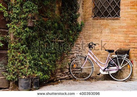 "A #bicycle leaning against a #wall of ""Buonconvento"", a small Tuscan #town"
