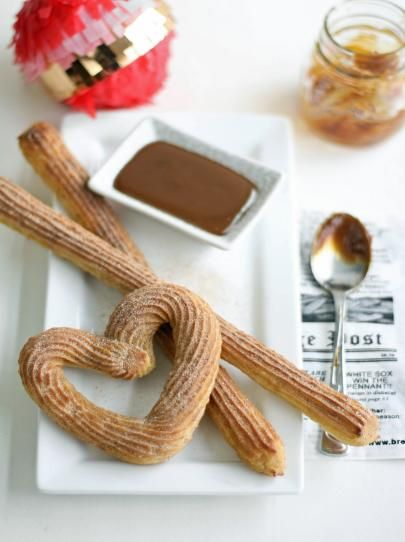 Baked Churros: Not the churros you're used to, but delicious all the same! Dusted with cinnamon sugar immediately after baking and served with dark chocolate sauce.