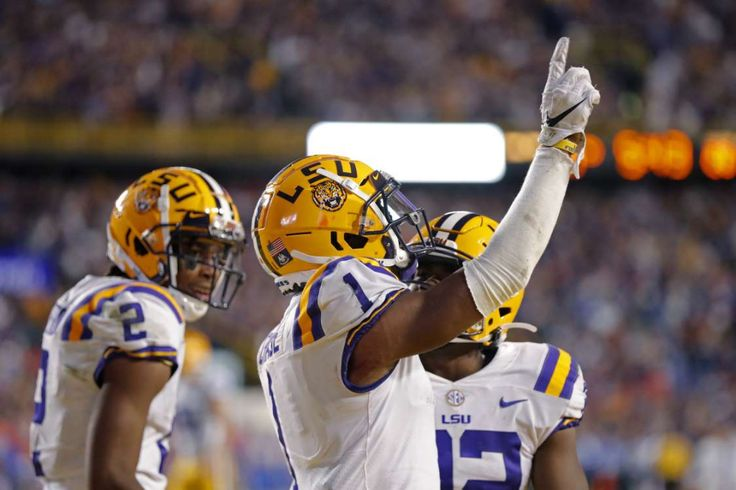 LSU wide receiver Ja'Marr Chase (1) celebrates his