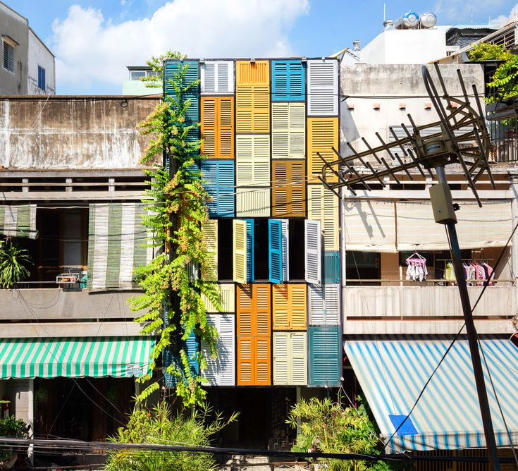 Vietnam's Vegan House is covered from top to bottom in vibrantly painted shutters | Inhabitat - Sustainable Design Innovation, Eco Architecture, Green Building