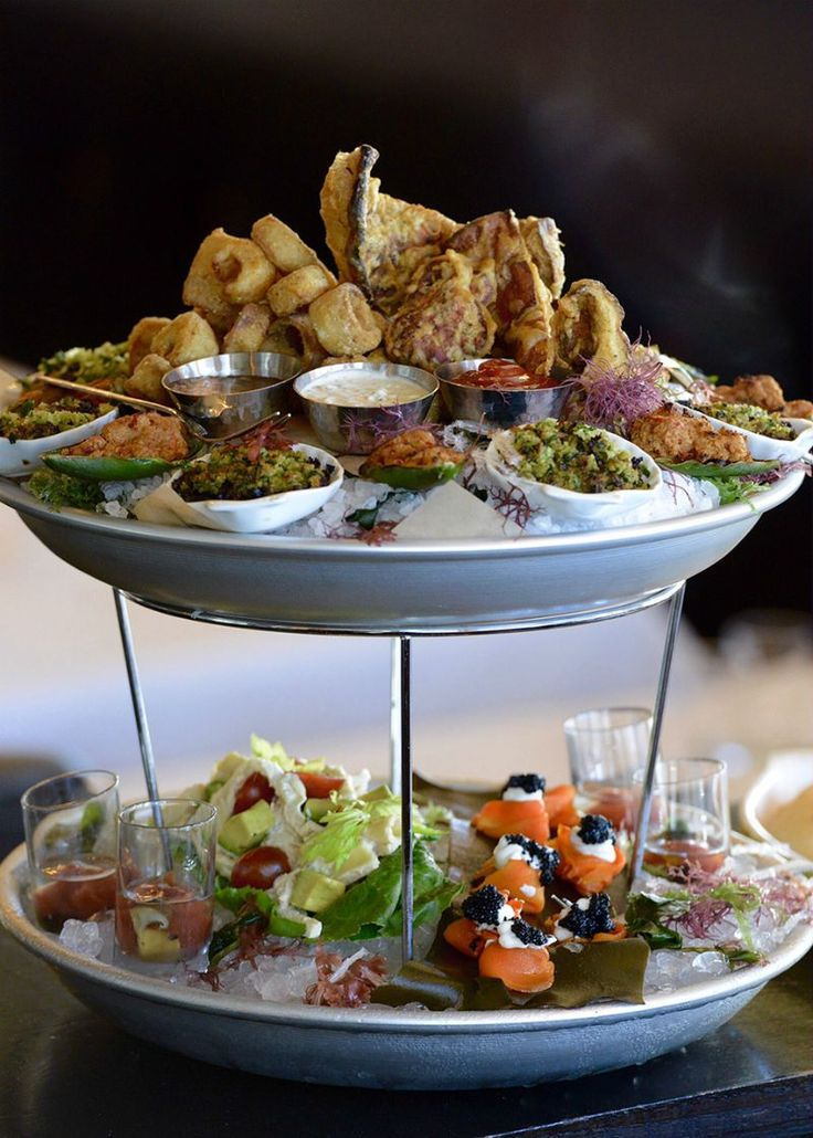 Behold the plant-based seafood tower that's revolutionizing the world one palate at a time. Including artichoke oysters Rockefeller, smoked-carrot lox with kelp caviar, and sustainably sourced hearts of palm calamari, the tower mimics the taste of seafood (without harming sea life) and brings fine dining to a whole new level.