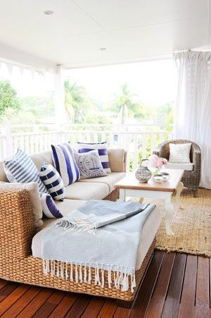 love the natural rattan/wicker furniture and natural woven area rug. Fresh, and coastal!