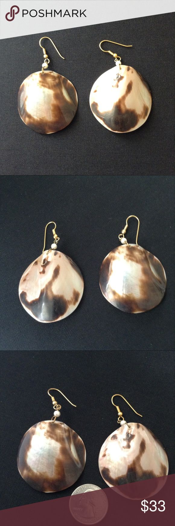 """Vintage Large Round Shell Earrings 1970's natural nacre shell earrings. Mottled brown with shimmering iridescent pearl hues. Translucent seashell, light, for pierced ears. The size and convex shape are marvelous. Almost 3"""" drop. Shell itself is 1&3/4"""" dia.    Excellent vintage condition. The sea is calling.... Vintage Jewelry Earrings"""