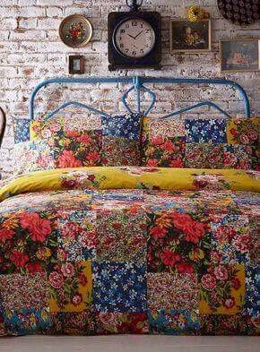 Love the fun vintage florals against the backdrop of exposed brick.