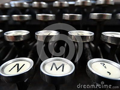 Classic Old Typewriter from the 1920's. Focus on the letters and buttons, horizontal shot