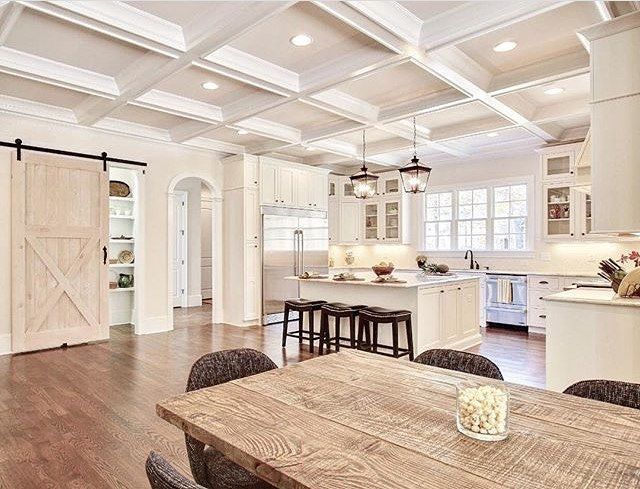 There's so much to love about this kitchen/eating area! What's your favorite part? Reposted from @jeanctaveras. #kitchen #hardwoodfloors #cofferedceiling #barndoor #chandelier #crownmolding #homedecor #homedesign #interiordesign #realestate #dreamhome #inspo #decor #beautifulhomes #luxury #goals #follow #design