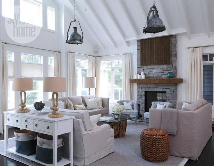Beach house decor: A light-filled cottage living room with rope-based table lamps, driftwood coffee table and pendant light salvaged from a ship {PHOTO: Robin Stubbert}