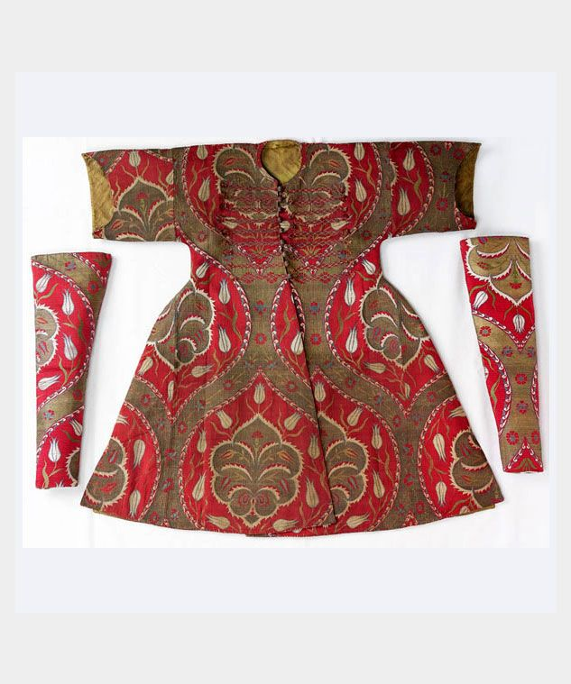 Ottoman Silks Originally a design hand-woven in pure silk for a child\'s kaftan of the last quarter of the 16th century and believed to be worn by the princes of Murad III (1574-1595). Only 71.5 cm in length it has short sleeves and the front is cut on the diagonal as with all traditional kaftans. Inventory number 13/265 from the Royal Wardrobe Collection, Topkapi Palace, Istanbul. 4 / 6