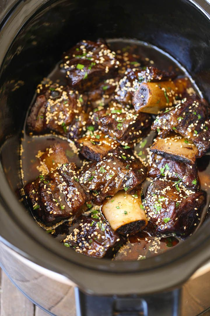 Slow Cooker Asian Short Ribs - Literally fall-off-the-bone tender! And all you have to do is throw everything into a crockpot.That