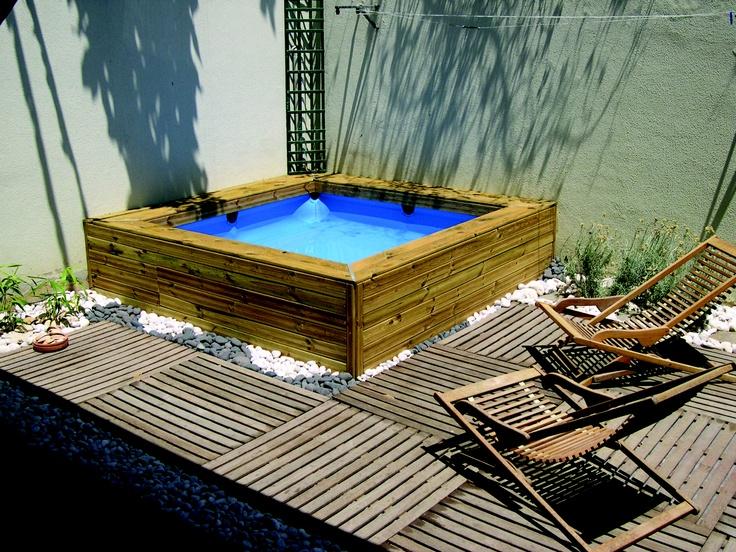 Piscina infantil gre forrada con lamas de madera se trata for Ideas para piscinas intex