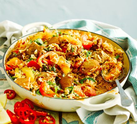 A low-fat spicy chicken one-pot with peppers, tomatoes and fresh red chillies - three of your five-a-day