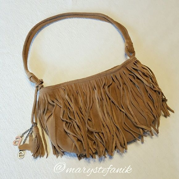 """American Eagle Fringe Brown Suede Handbag Purse American Eagle Fringe Brown Suede Purse Handbag in excellent used condition. There is a black line though the tag. Measures approx 10"""" x 7"""". American Eagle Outfitters Bags Shoulder Bags"""