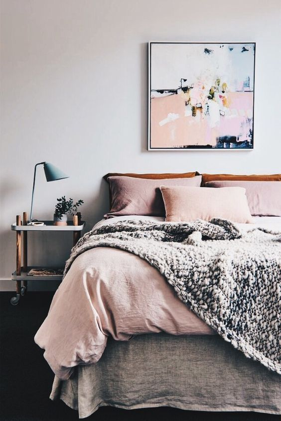 Trendy pink and orange pastel tone bedding. Modern yet very cozy bedroom that makes it hard to leave the bed early in the morning :)