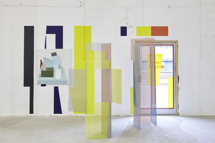 """Céline Condorelli, After Image (Gray and Bayer), 2015 — aluminum screen parts, cut vinyl on existing window, wall painting — with Nathalie Du Pasquier, Painting with no title, 2013, oil on canvas. Photo by Stuart Whipps, courtesy of Eastside Projects. Read Maeve Connolly on this work, and on Condorelli's """"copies, mirrors, ghosts"""" at The Exhibitionist."""