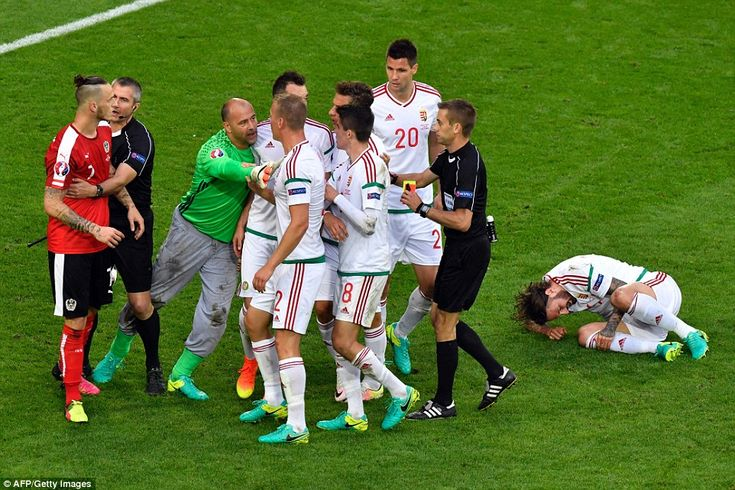 Tamas Kadar lies injured as Gabor Kiraly ensures his Hungary team-mates do not confront Marko Arnautovic after Dargovic's tackle