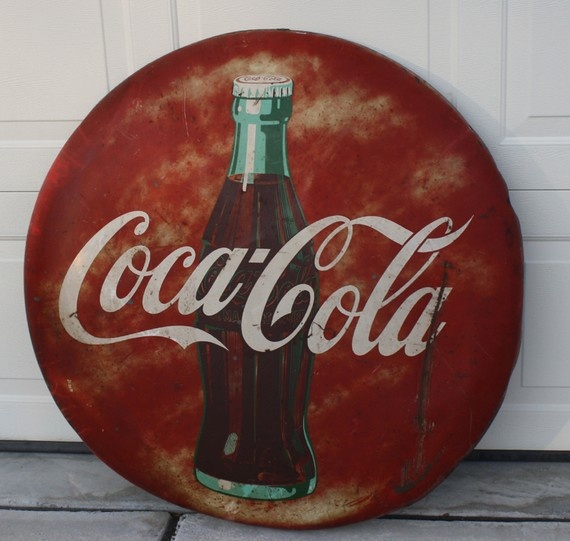 dating coke button signs In the us, most outdoor signs made between 1890 and and 1950 were constructed of a base of heavy rolled iron, which was die cut into the desired shape, then coated with layers of colored powdered glass and fired in a kiln this process made them durable and weather-resistant signs made this way.