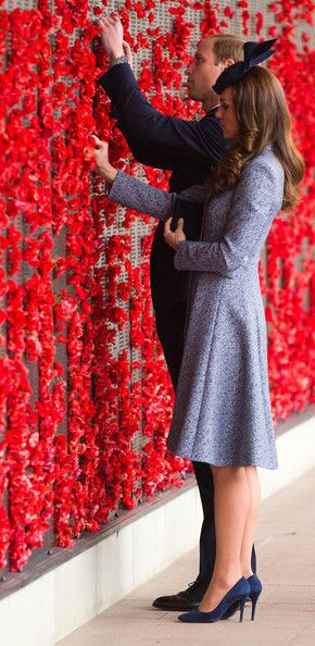 Catherine, Duchess of Cambridge and Prince William, Duke of Cambridge place a poppy flower into the World War I Wall of Remembrance during their visit to the Australian War Memorial on ANZAC Day on April 25 2014
