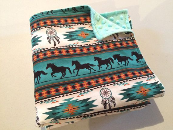 Cuddly soft teal dimple minky paired with teal Navajo horse print cotton baby blanket. Great for in the crib, stroller, car seat, travel and all round babys favorite blanky.  The super soft effects of minky will have your baby loving this blanket to cuddle up for nap time and bed time. You may even feel a bit jealous of your baby and want to cuddle the blanket yourself  Double stitched including top stitch for a finished look as well as more durability. Measures approx 30x40  Machine…