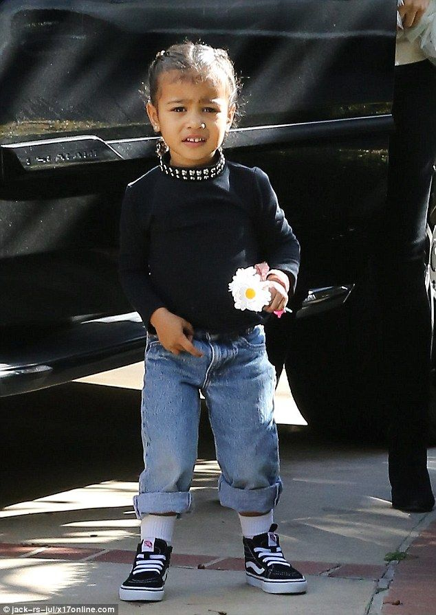 Flower girl! North West was photographed holding several blossoming white flowers when she...